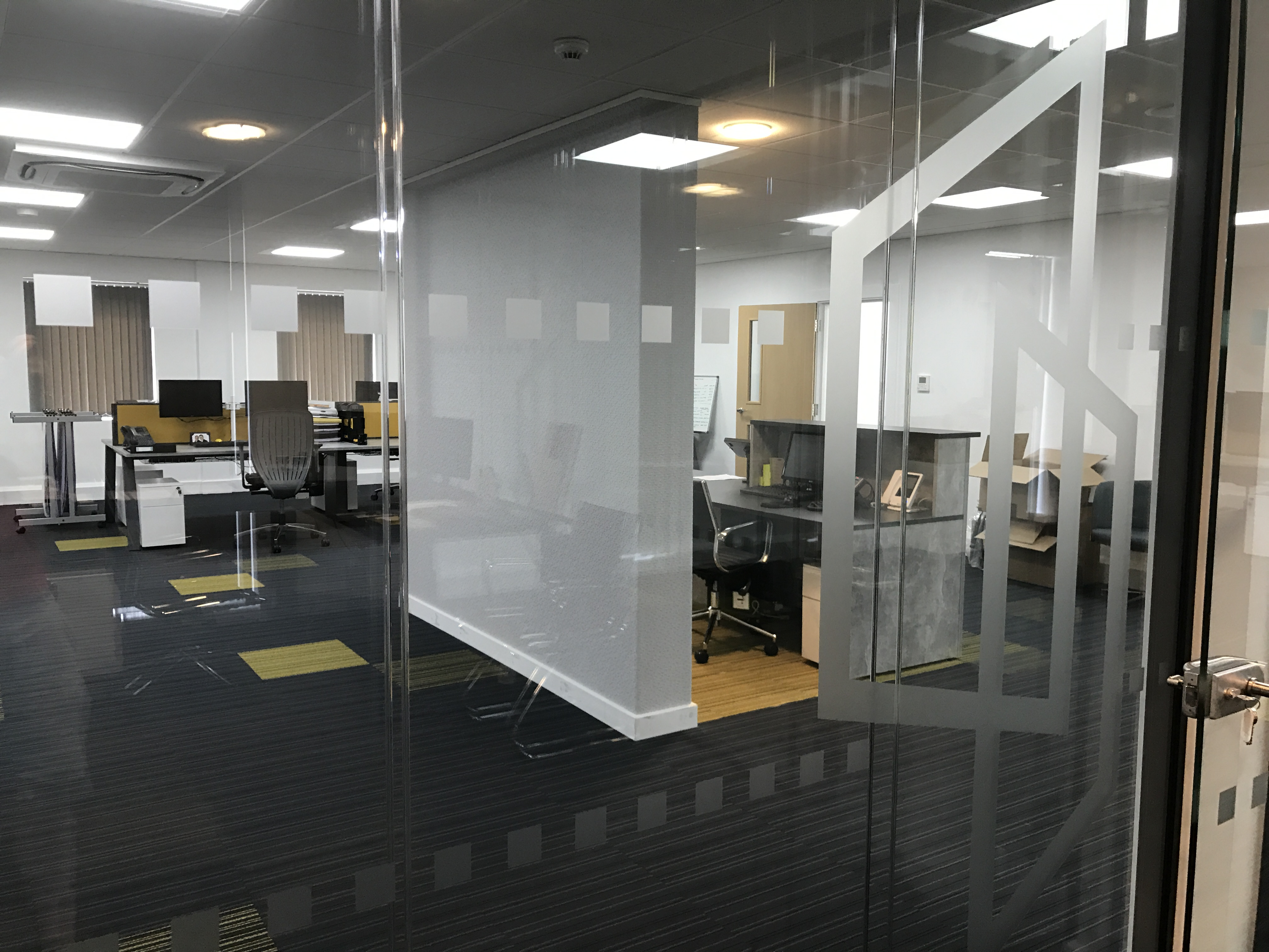 A picture showing how glass manifestation can be used for office interiors